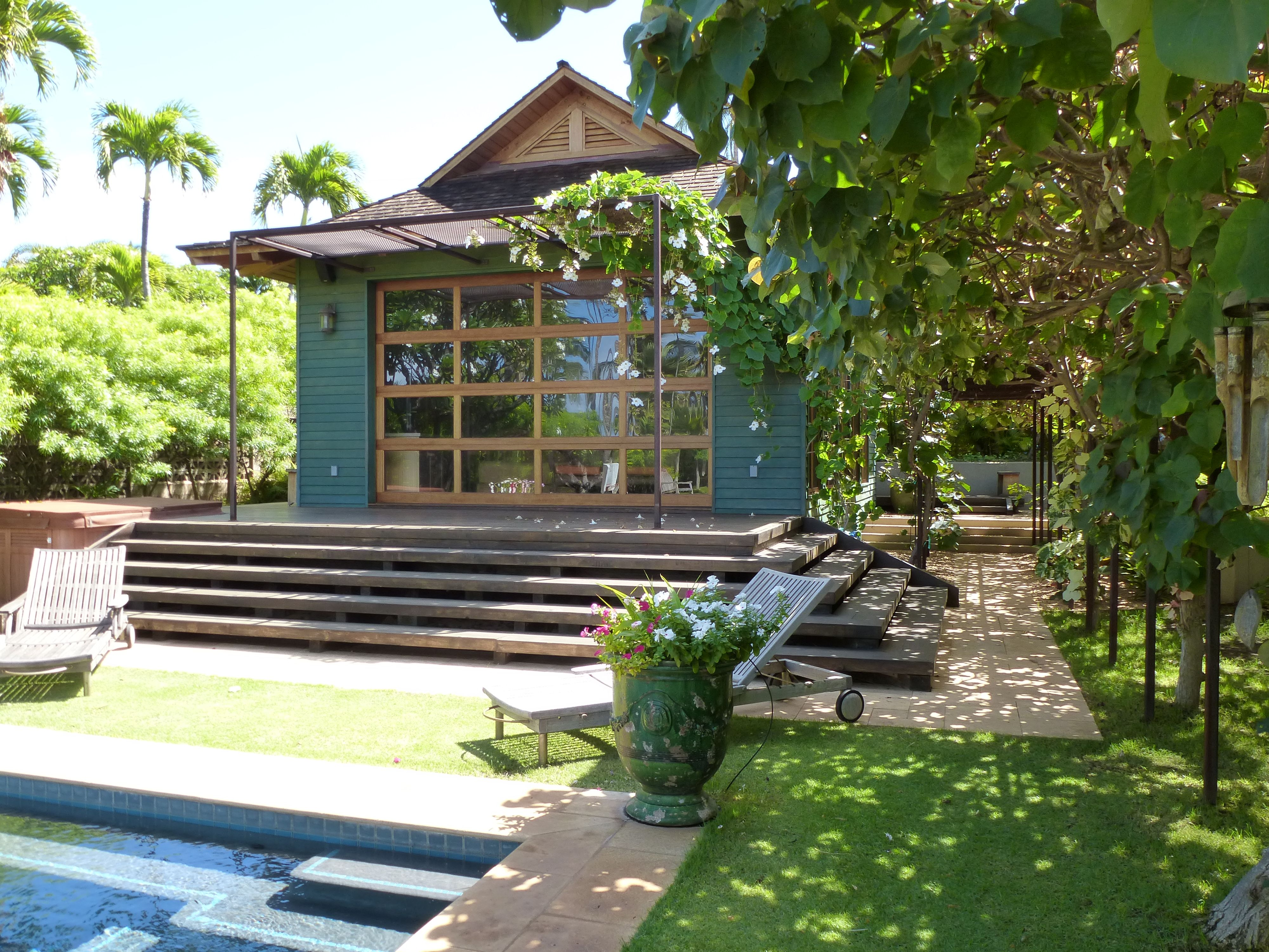 MHD maui pool house with glass garage door