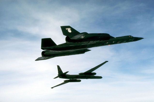 1988 photo shows SR-71 with TR-1 in the background. The TR-1, a larger and considerably upgraded version of the original U-2, was later redisignated as U-2R.
