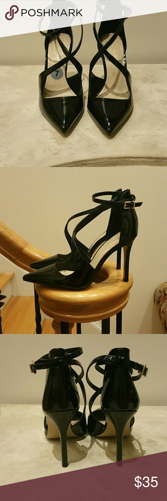 """BCBGENERATION  Heels Black Patent leather with criss-cross straps across the foot and buckle at ankle and 4"""" heels. Brand new. Never worn. Price Firm BCBGeneration Shoes Heels"""