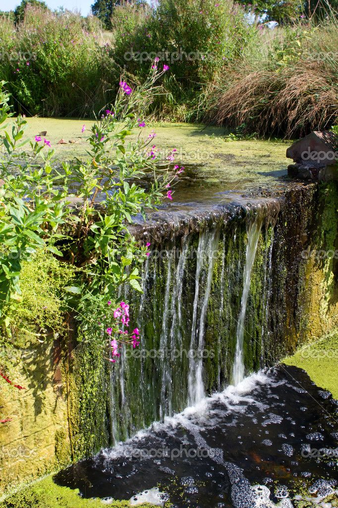 Small Man Made Waterfall In The English Countryside English