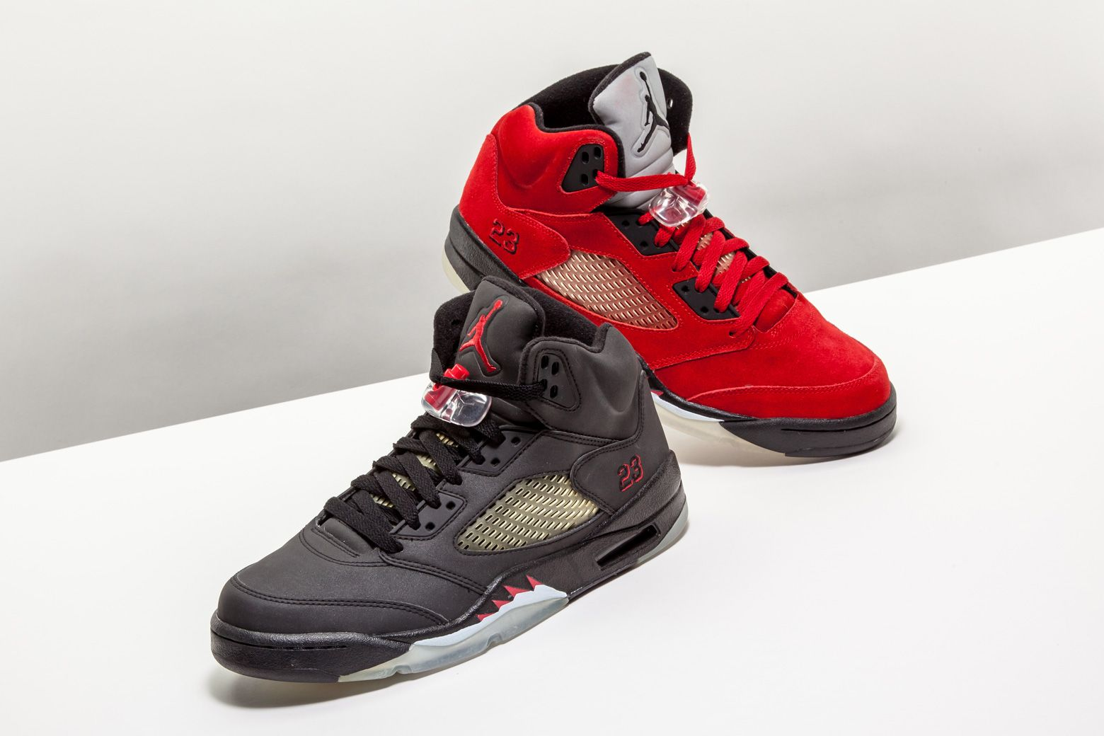 "low priced 253f2 2fc59 2009 s Air Jordan 5 Retro ""Raging Bull"" Pack features one pair in red suede    another in reflective black material."