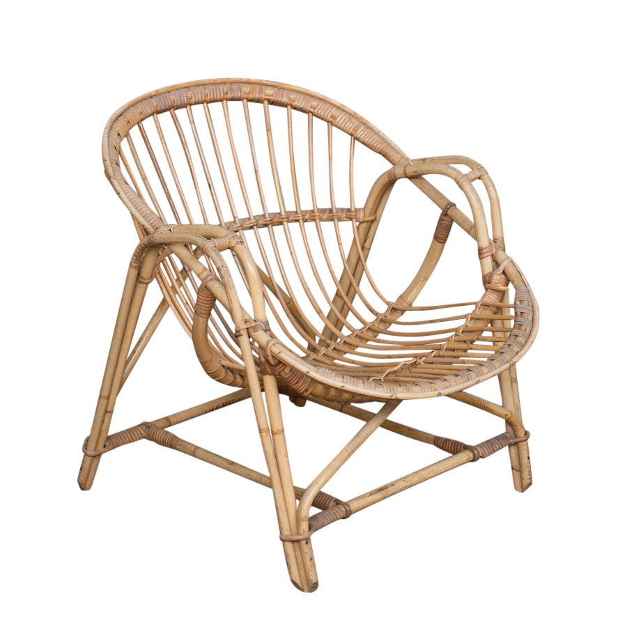 Mello Rattan Chair at Found Vintage Rentals. These vintage rattan chairs are fun for a casual lounge. Add pillows and throws for comfort.