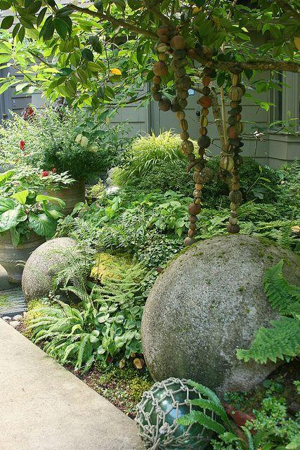 Great Concrete Balls Nestled In Shade Garden.