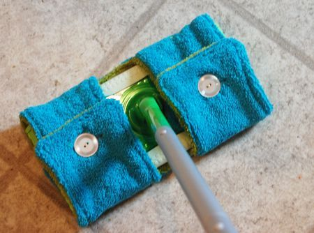 Click photo for Swiffer Cover pattern.  Can use one layer of toweling backed with a cotton print and sew a little bit to show on the top of the cover and can round off corners. May use hook and loop tape to secure the cover and use buttons for looks