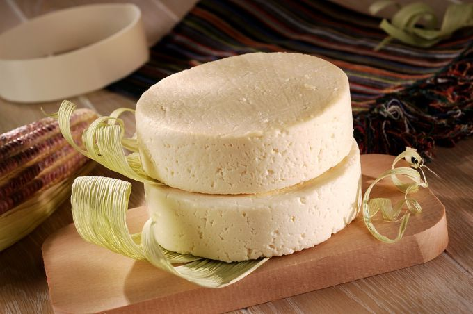 A finished wheel of queso fresco