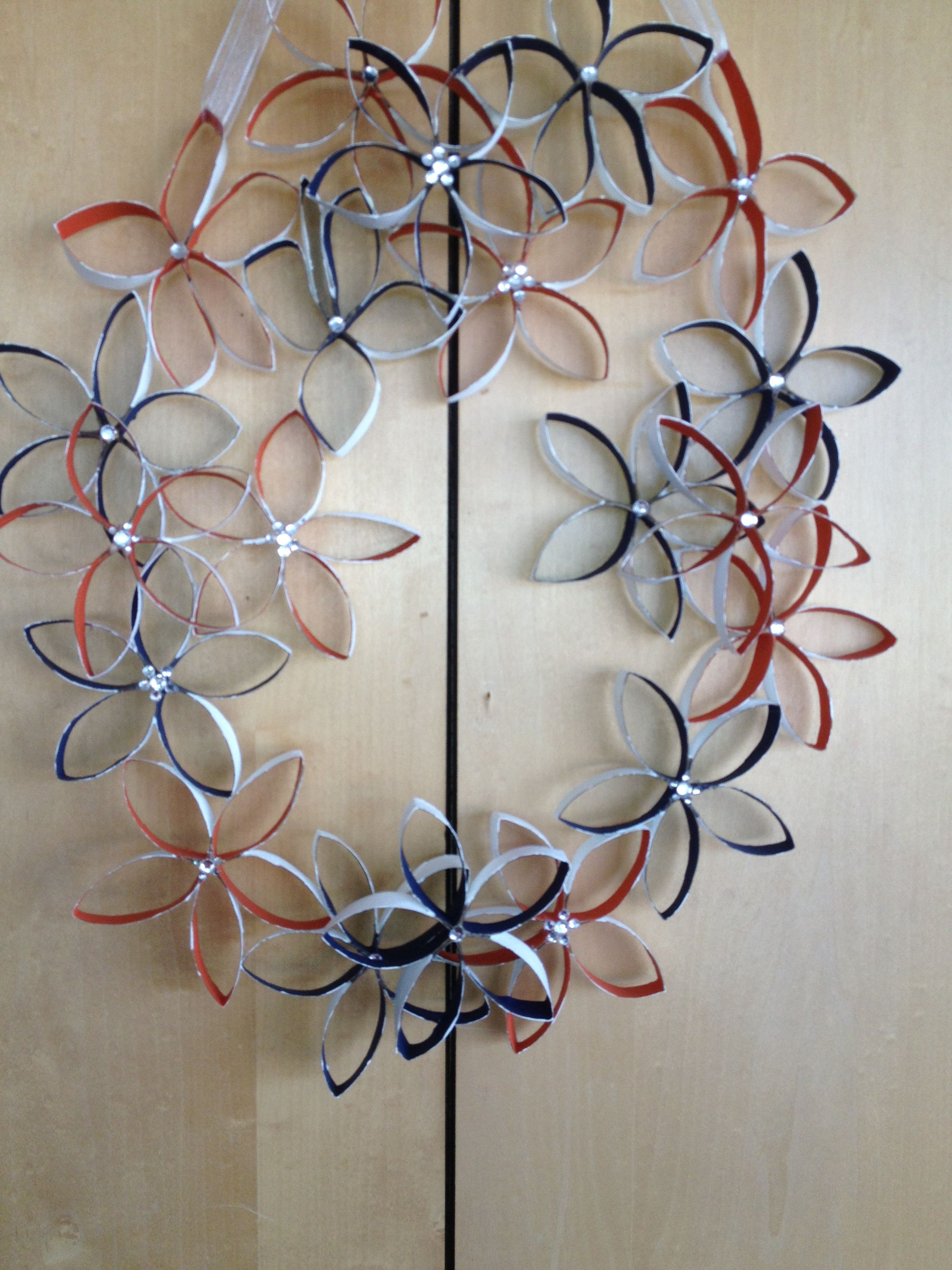 Paper towel roll flower wreath with gem in center Toilet