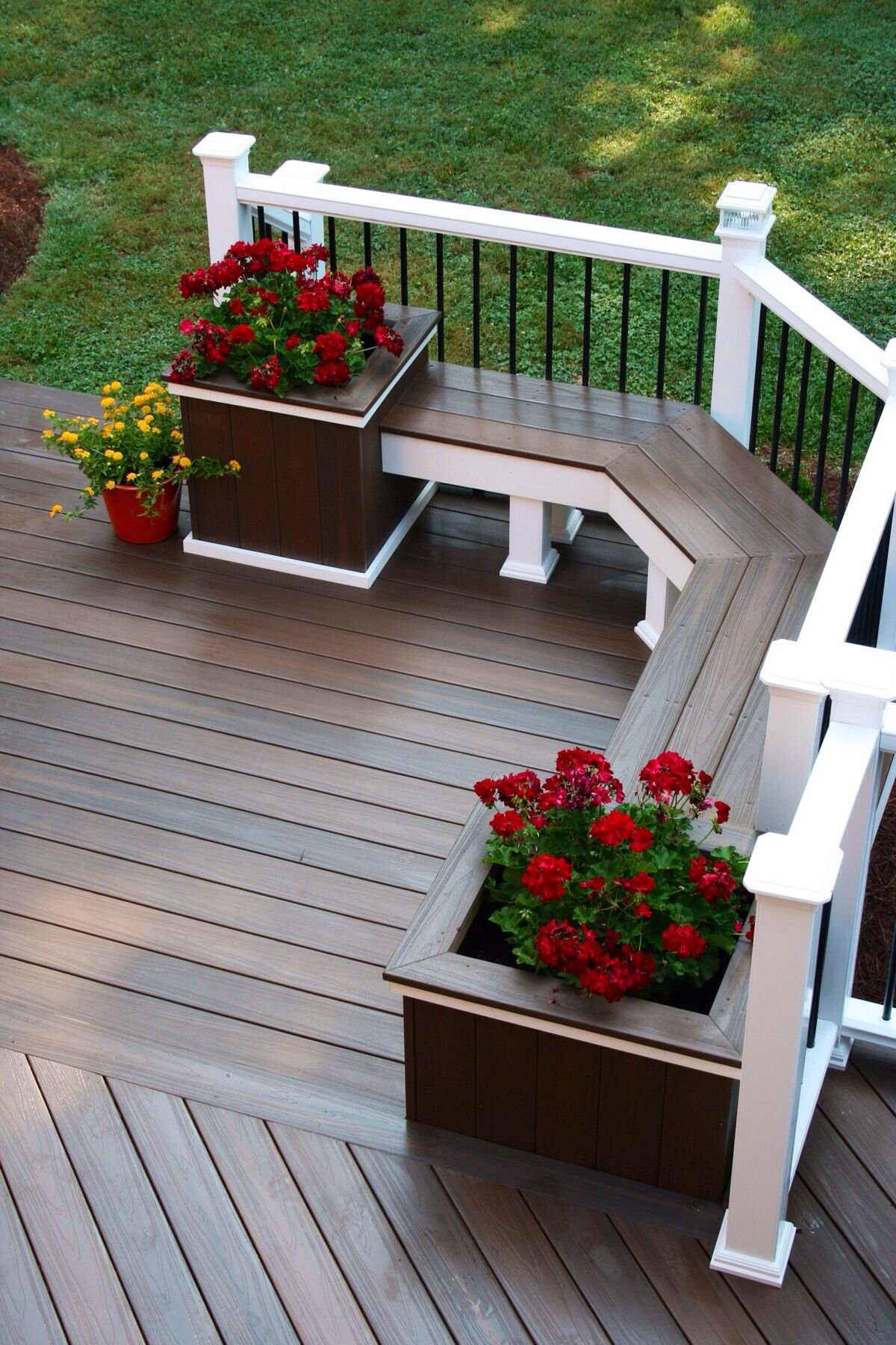 add a deck bench with potted plants for a relaxing place to sit