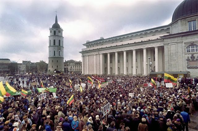 Lithuanians Carry Lithuanian Flags In The Center Of Vilnius On