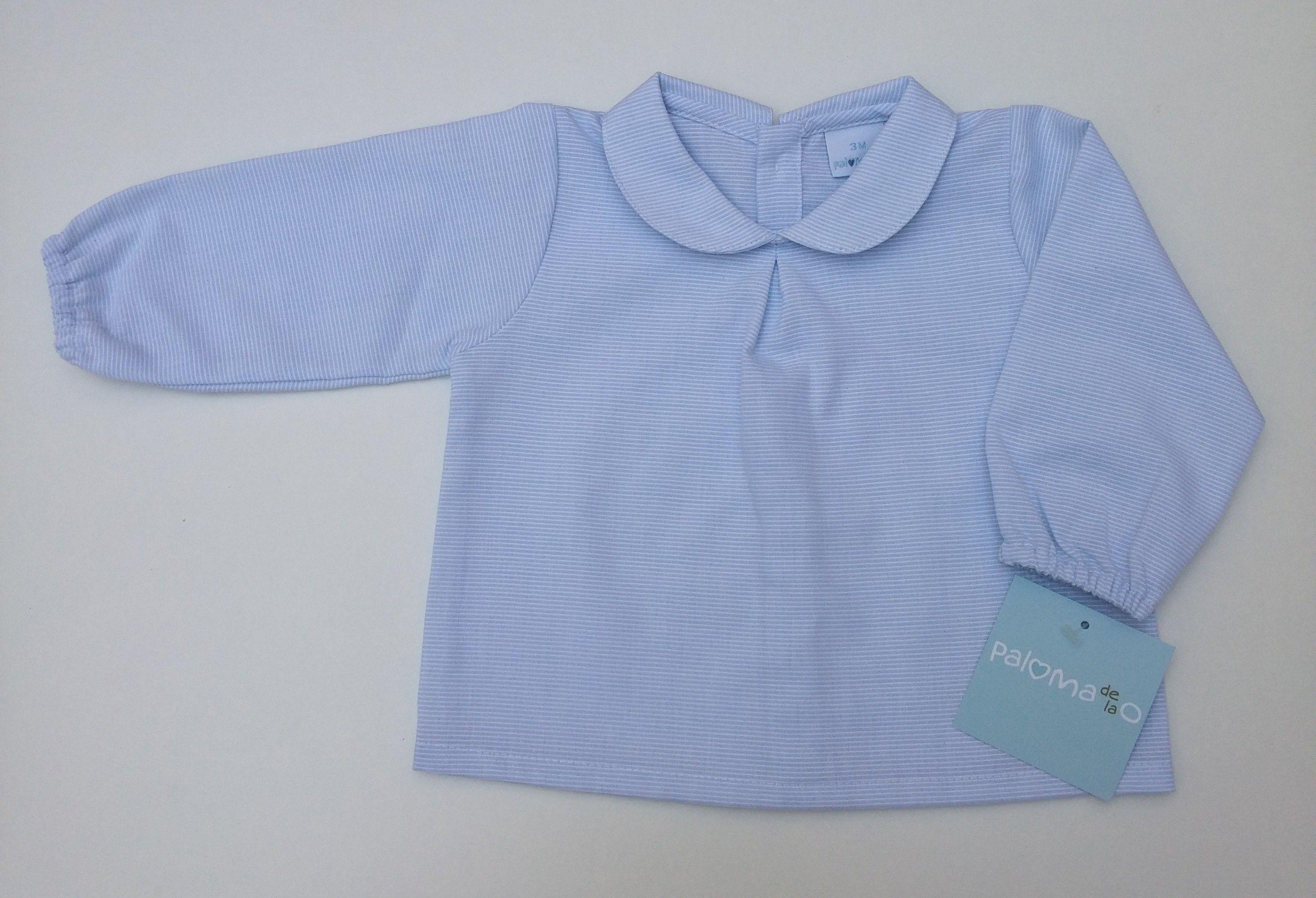 38904d6d0 Camisa azul celeste con cuello bebé.