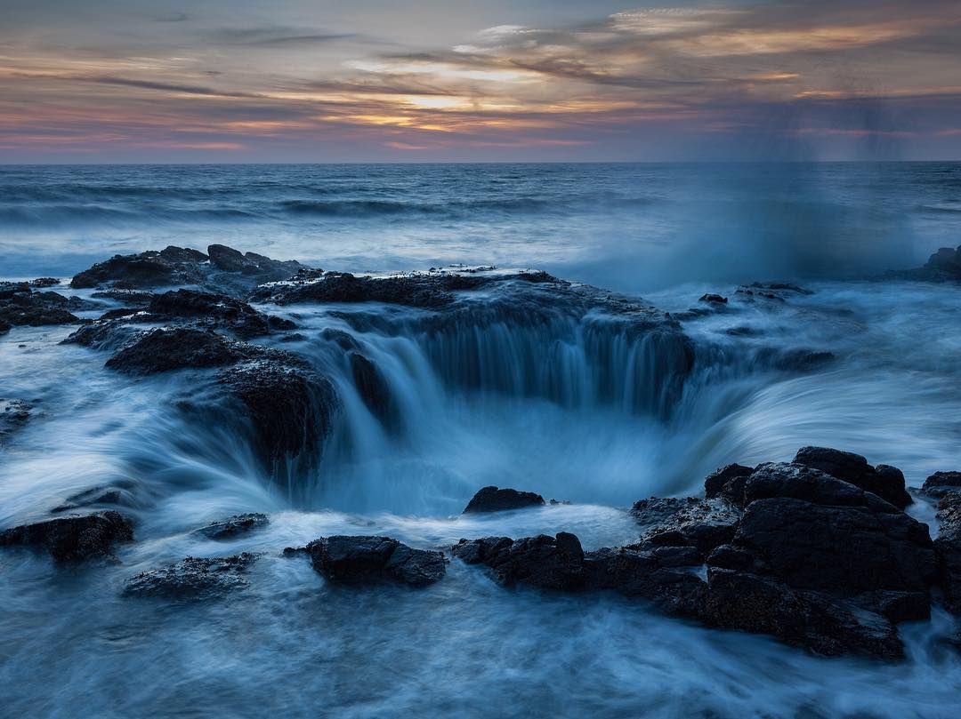 Into the Deep | Photograph by Gary Fua |  Seawater pours into the gaping maw of…