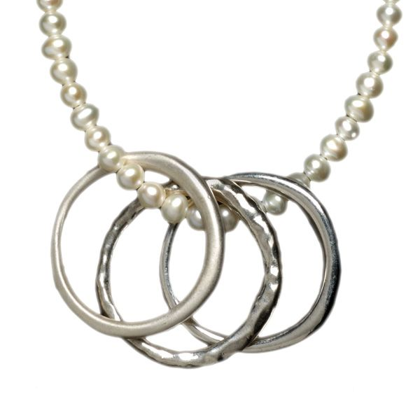 I love this simple necklace for a wedding...the three bands which are symbolic and the pearl strand is classic.  Gorgeous wedding necklaces in this post and also a couple of cool wedding necklaces for the bridesmaids and the bride.