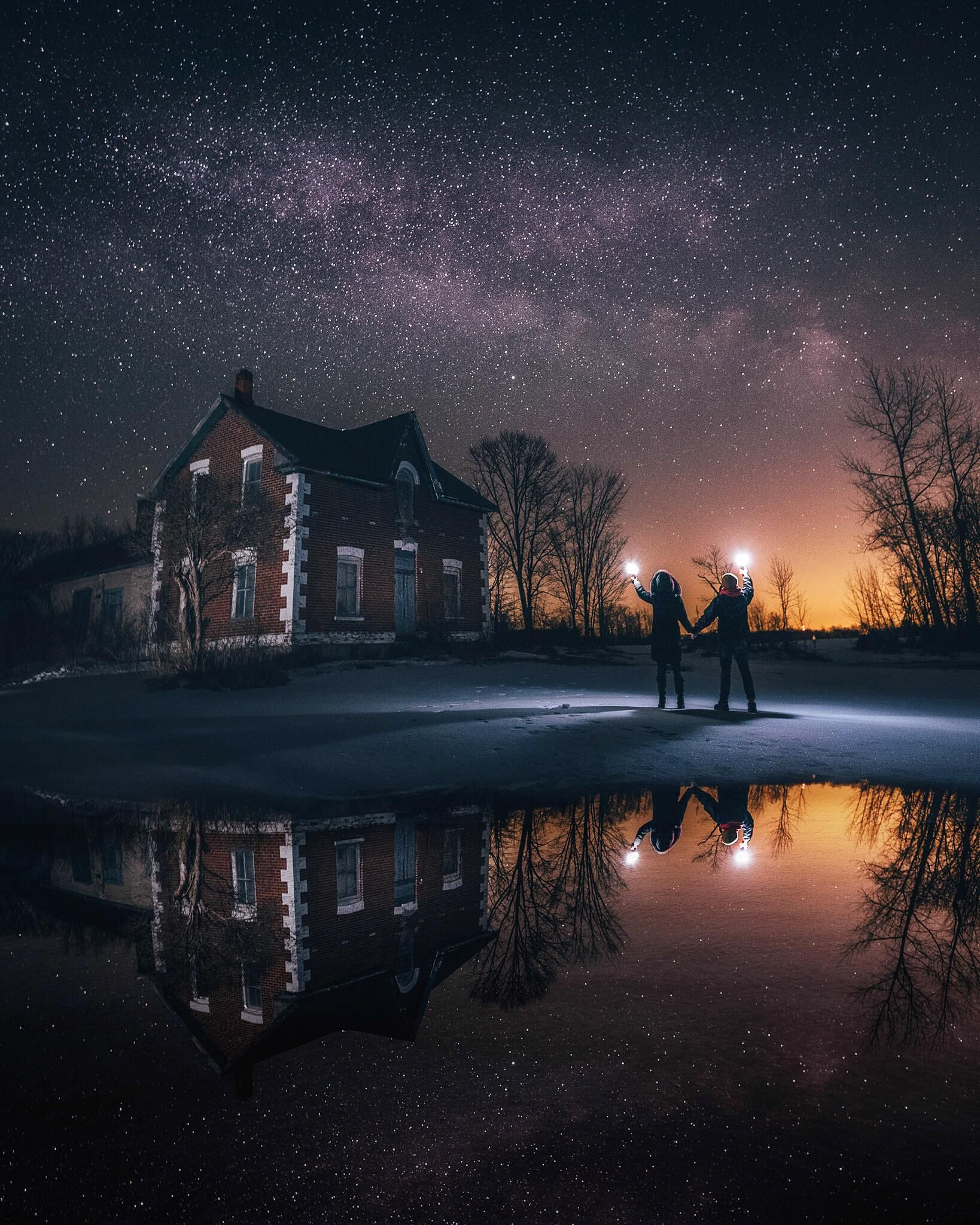 The Night Sky An Old House And A Puddle