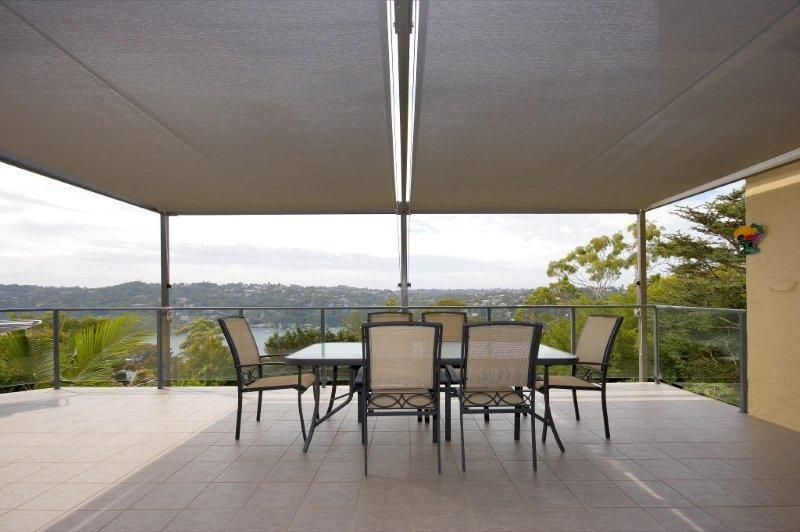 Two Retracting Awnings With Frame And Poles In Shade Fabric The Owners Now Have A Flexible Outdoor Ente Patio Umbrella Outdoor Entertaining Area Outdoor Decor