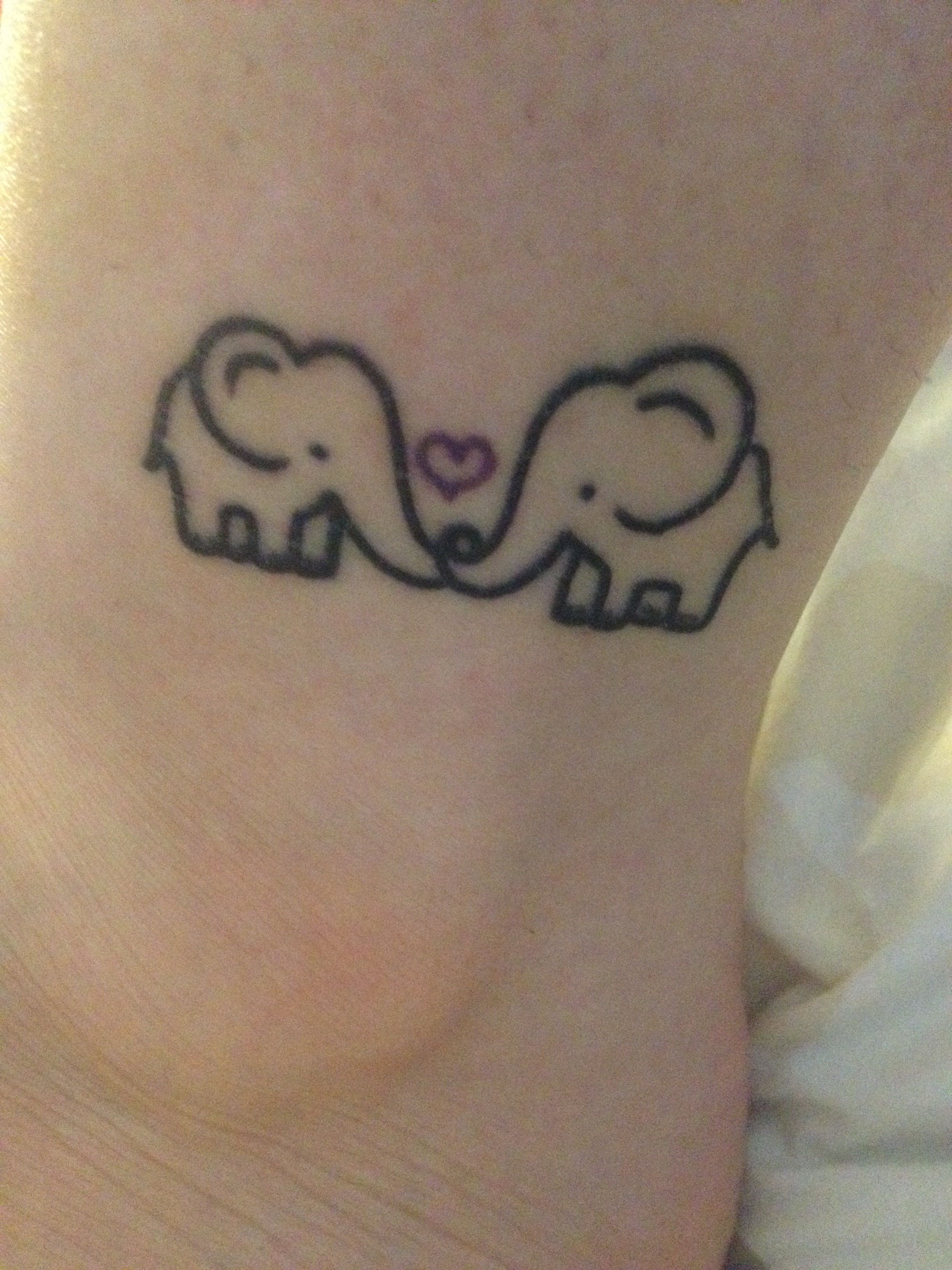 small elephant tattoo i got this to represent me an my mom the heart is purple for her birth. Black Bedroom Furniture Sets. Home Design Ideas