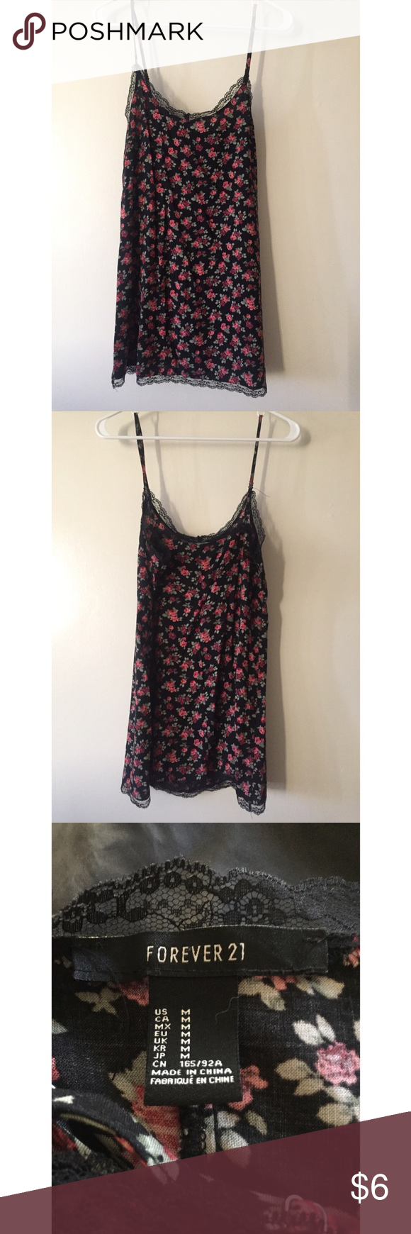 90s inspired floral dress only worn once! it's very 90s inspired because of how tight fitting it sits on the body but is still loose (not bodycon). black lace trimming on the top. Forever 21 Dresses Mini