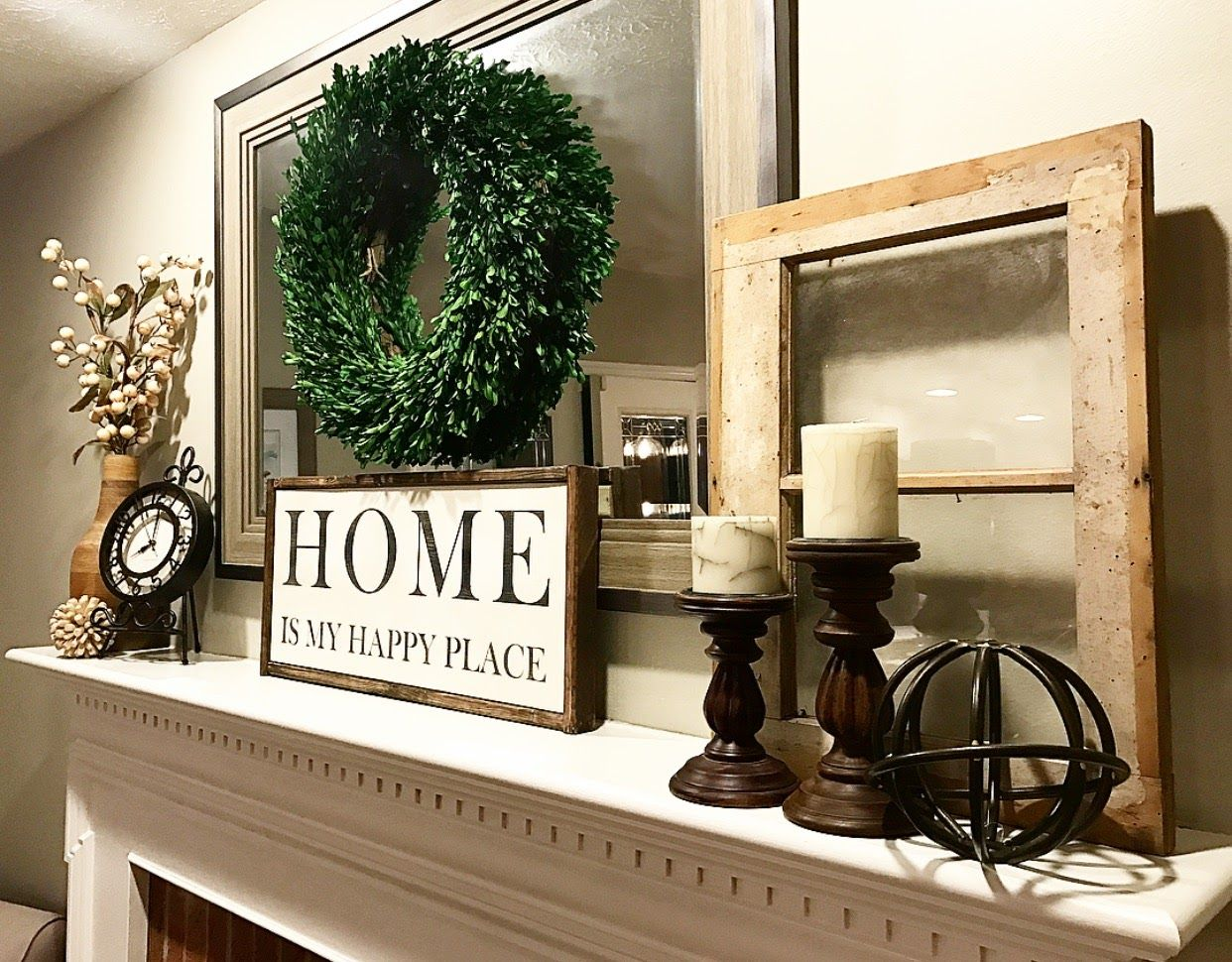 Mantle decor. Love mixing wood accents and dried greenery.