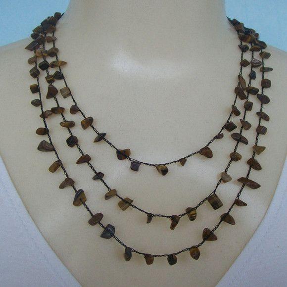 Conjunto feito em crochê com pedra natural olho de tigre e linha preta própria para bijuterias finas. R$20,00