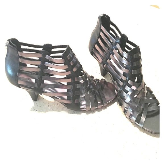 Gladiator leather sandals  Johnston& Murphy Black and metallic beautiful leather gladiator sandals with heel zipper. Size 7.5. Worn once indoors. Johnston and Murphy. Make me an offer! Johnston & Murphy Shoes Sandals