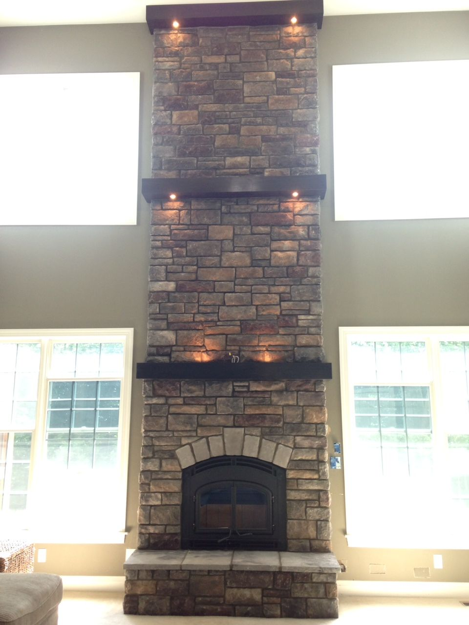 Cultured stone fireplace surround - Chardonnay Limestone By Boral Cultured Stone With Three Wood Mantels With Built In Lighting