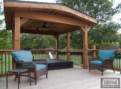 Gable Roof Covered Cedar Deck with Hot Tub Stamped Concrete Patio