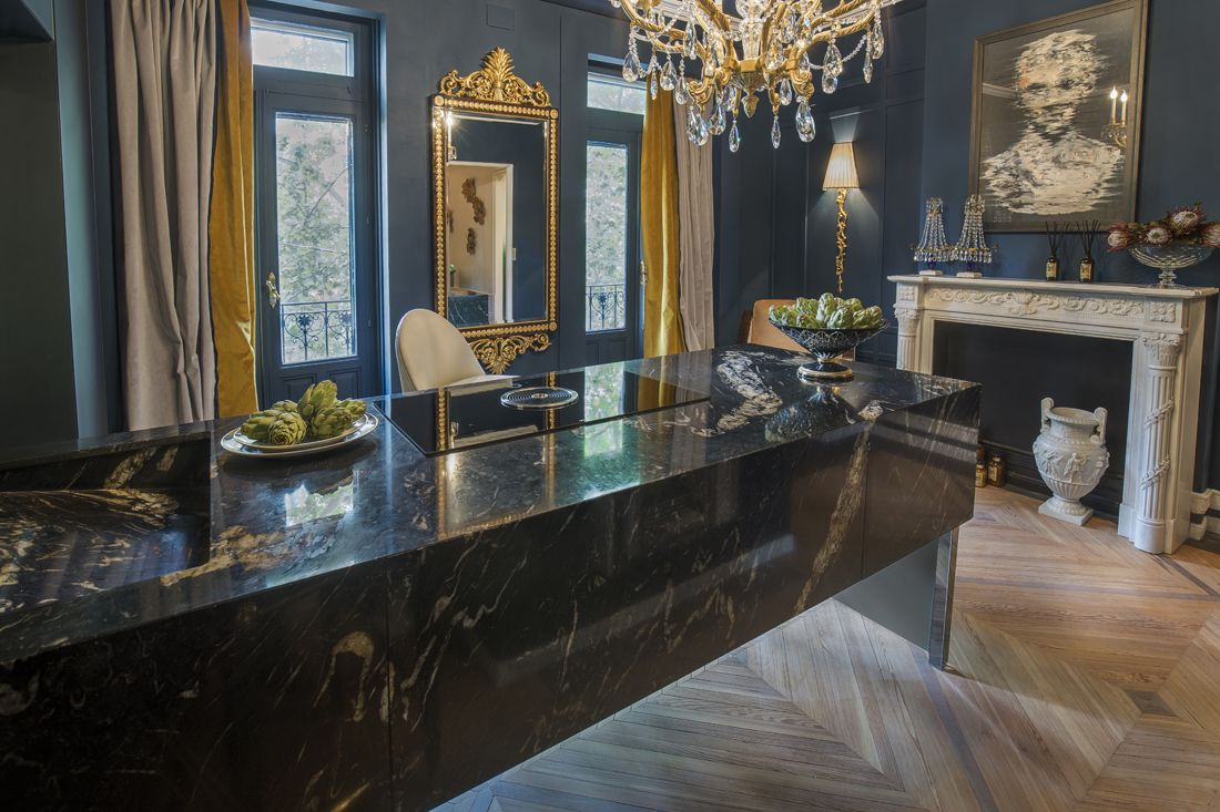 Shedding some light on this exquisite Dark Pearl #countertop from the natural Granith collection. Virginia Albuja, have created a spectacular space at Casa Decor merging classic and contemporary styles in her design.  You can check out more Neolith and Granith applications at Casa Decor until June 18th.  #Granith #naturalstone #thesize #design #interiors #durability #style #Neolith