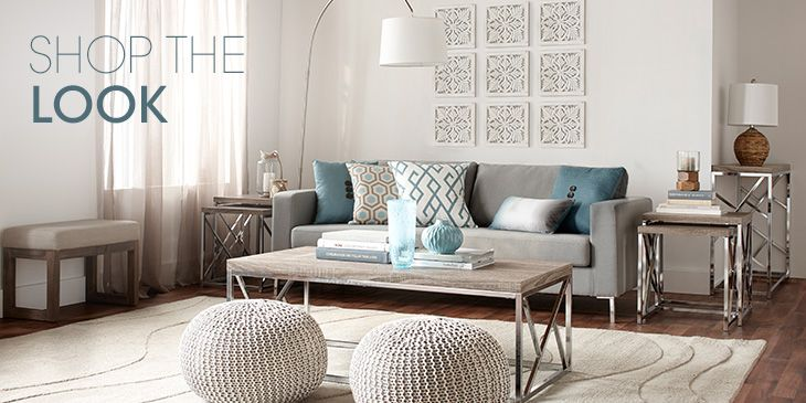 A cozy living room in shades of ivory with turquoise and wooden