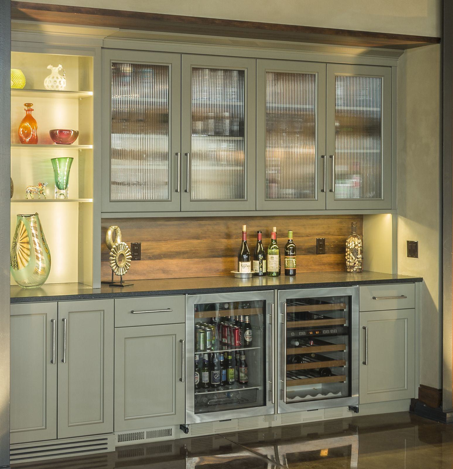 Side By Sub Zero Beverage Center And Wine Cooler Are Stage In This Bar Sitting Just Outside The Kitchen A Home With An Open Floor Plan