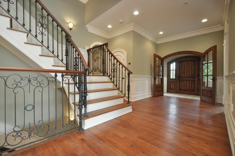 Foyer And Stairwell With Walls In Behr Clary Sage Green Painted Walls Sage Green Paint Home Remodeling