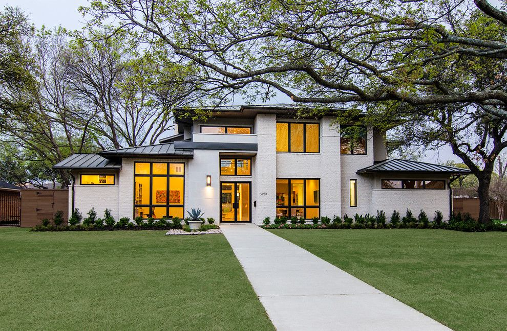 White house brown roof exterior contemporary with glass door
