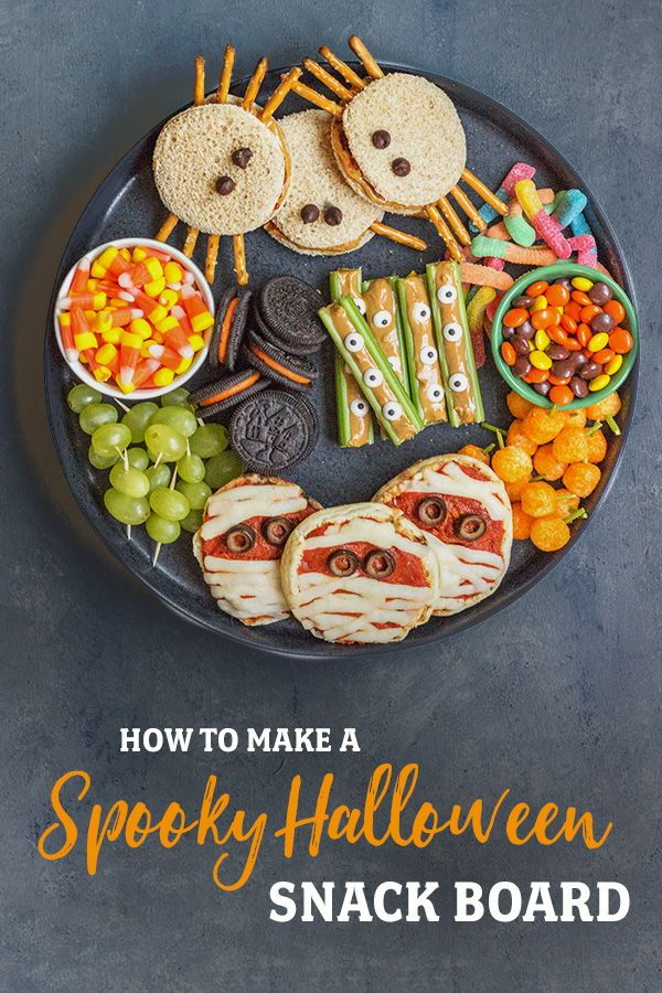 How to make a Spooky Halloween Snack Board. Get tips and directions to make healthy celery eyeball snacks, almond butter and jelly spiders, and mummy pizzas topped with black olives. Try these kid friendly appetizers for your Halloween party! #halloween #snacks #halloweensnacks #appetizer #halloween