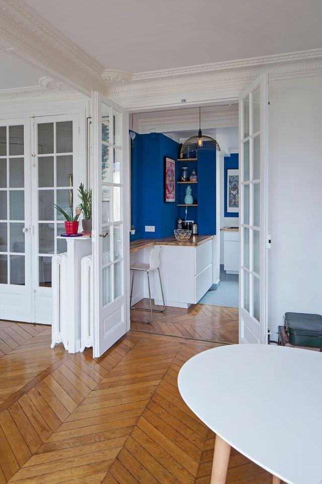 Cuisine ouverte sur le salon  une pièce chaleureuse dans un - salon sejour cuisine ouverte