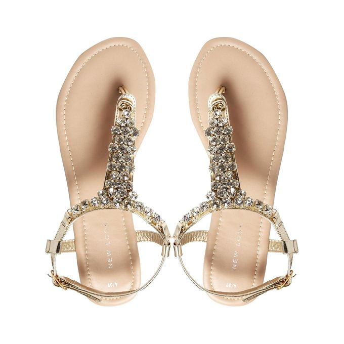 be857e89c Brides.com  34 Fashionable Wedding Flats . Fossil gold bling thong flat  sandals