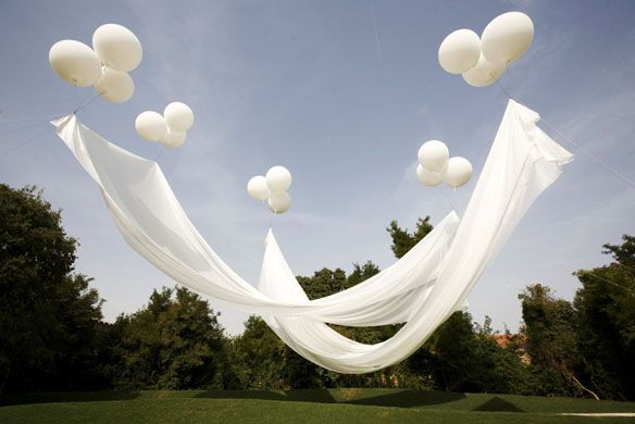 Floating canopy. Balloons attached to the ground with fishing line