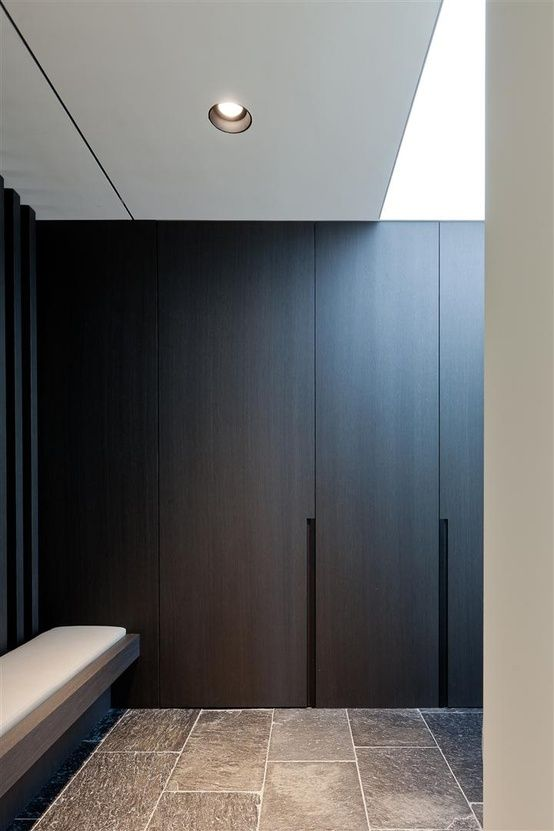 Appears to be a foyer with a very cool built-in/flush with wall bench and coat closet. Designed by iXtra Interior Achritecture. http://www.ixtra.be Photo by Thomas De Bruyne. www.cafeine.be