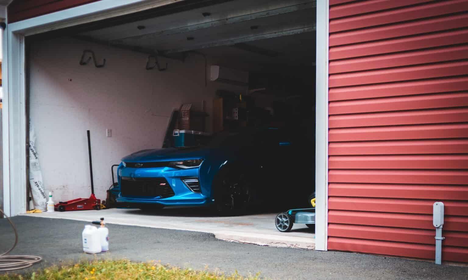 5 Tips For Designing A New Garage In 2020 Garage Door Repair Spring Concrete Decor Garage Door Installation