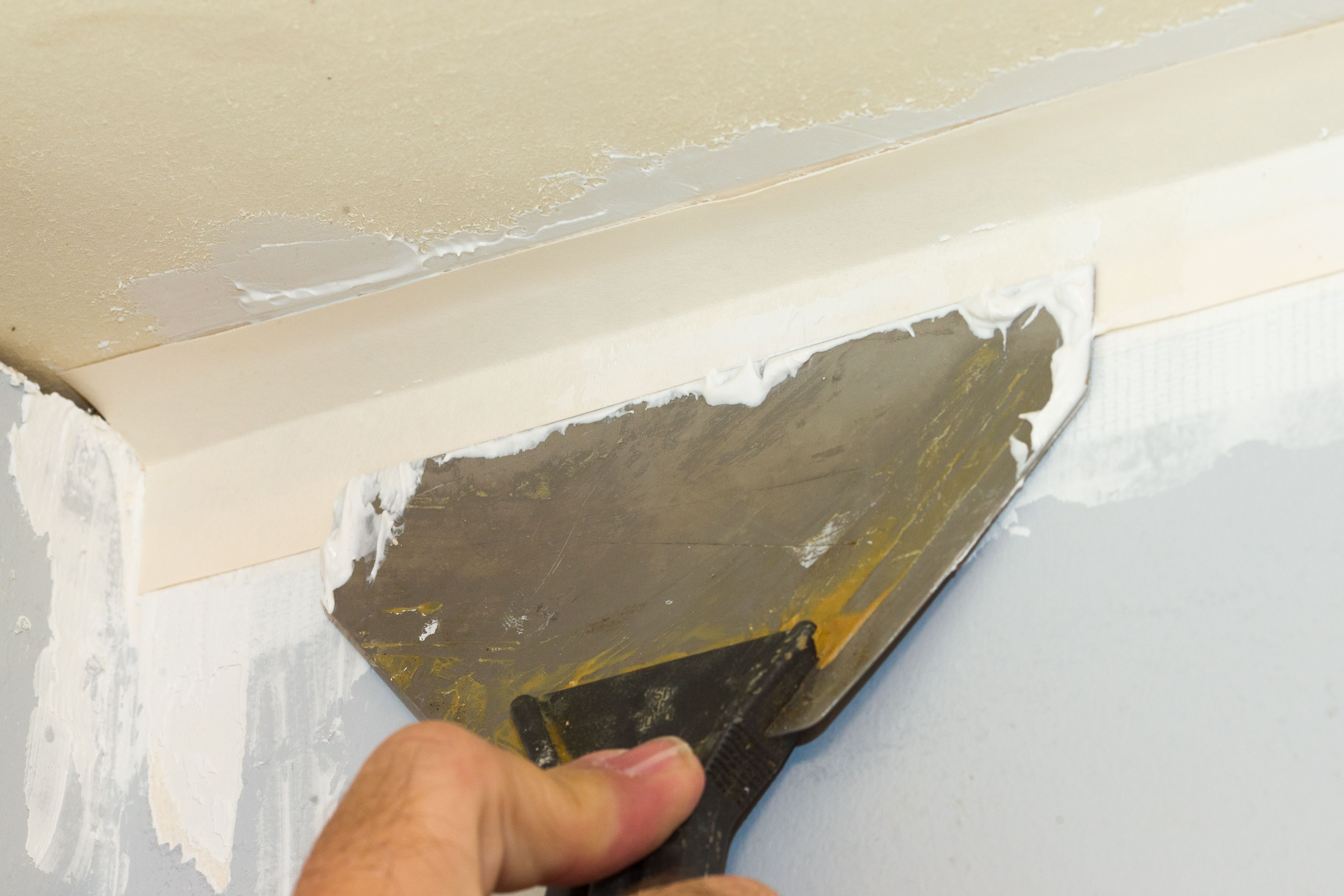 How To Fill A Gap Between The Wall The Ceiling Hunker Repair Ceilings Drywall Repair Ceiling Drywall Repair