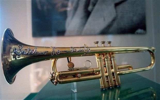 Louis Armstrong's trumpet on display at an exhibit at Queens College in New York at the Louis Armstrong Archive—I want to see this!!!