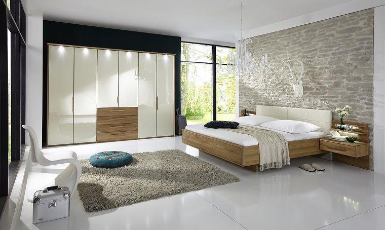 camera-da-letto-moderna-parete-mattoni-armadio-bianco-letto ...
