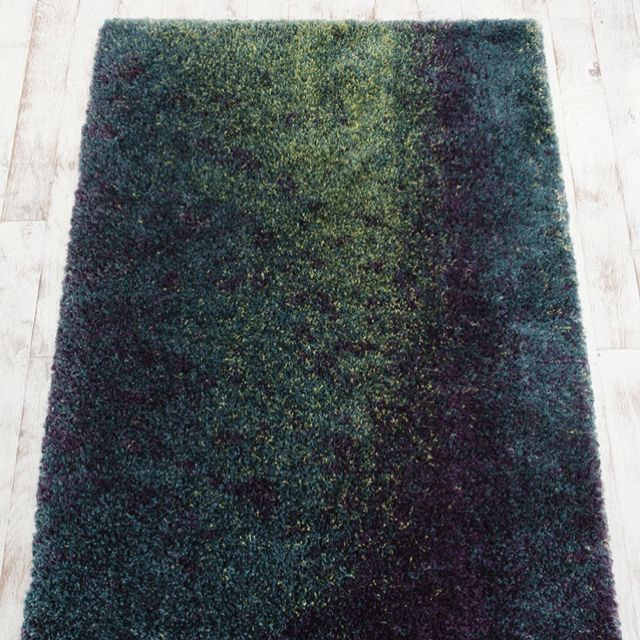 This peacock rug for my purple room