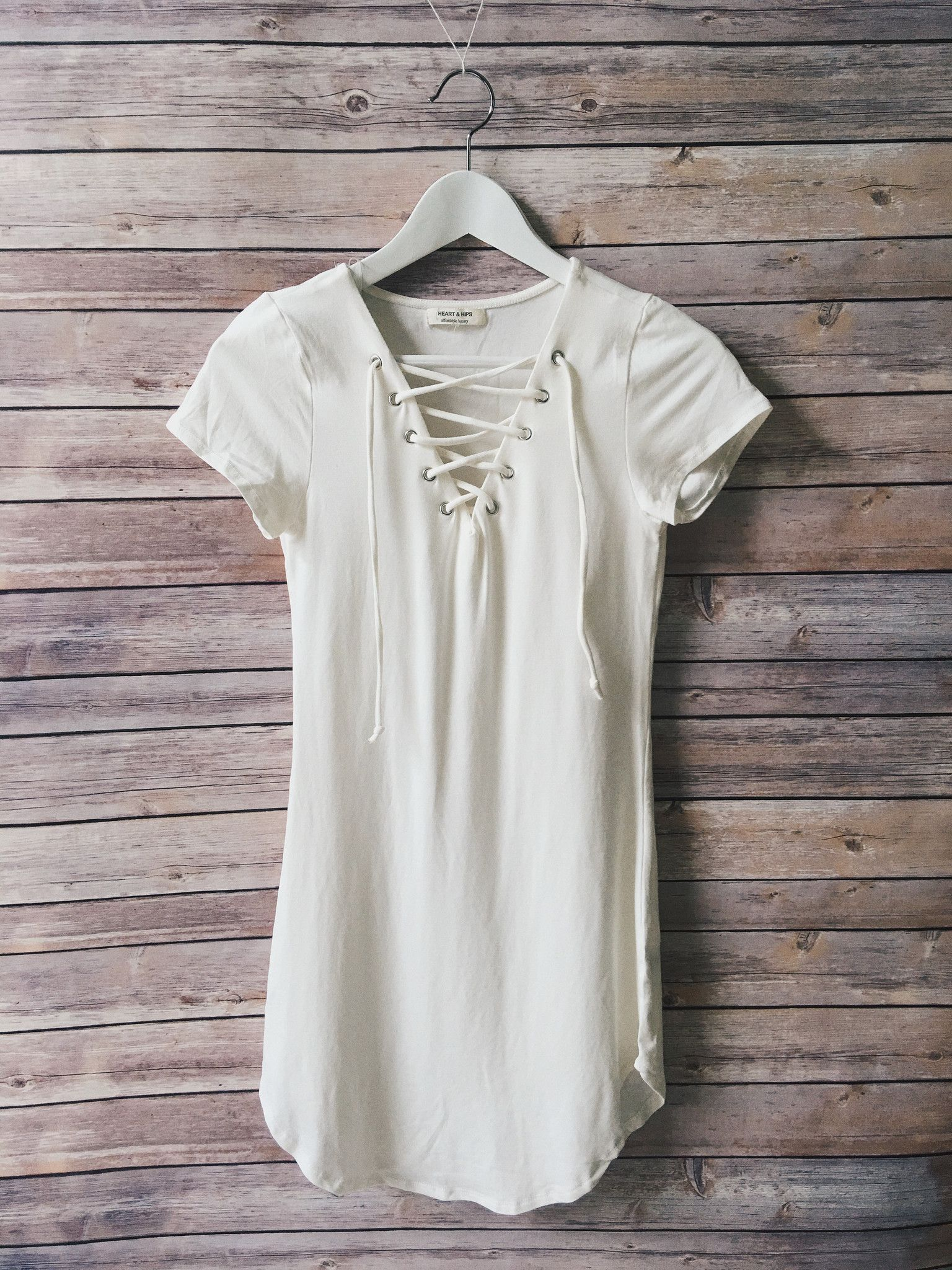 Front eyelet short sleeve dress in a soft white color attire