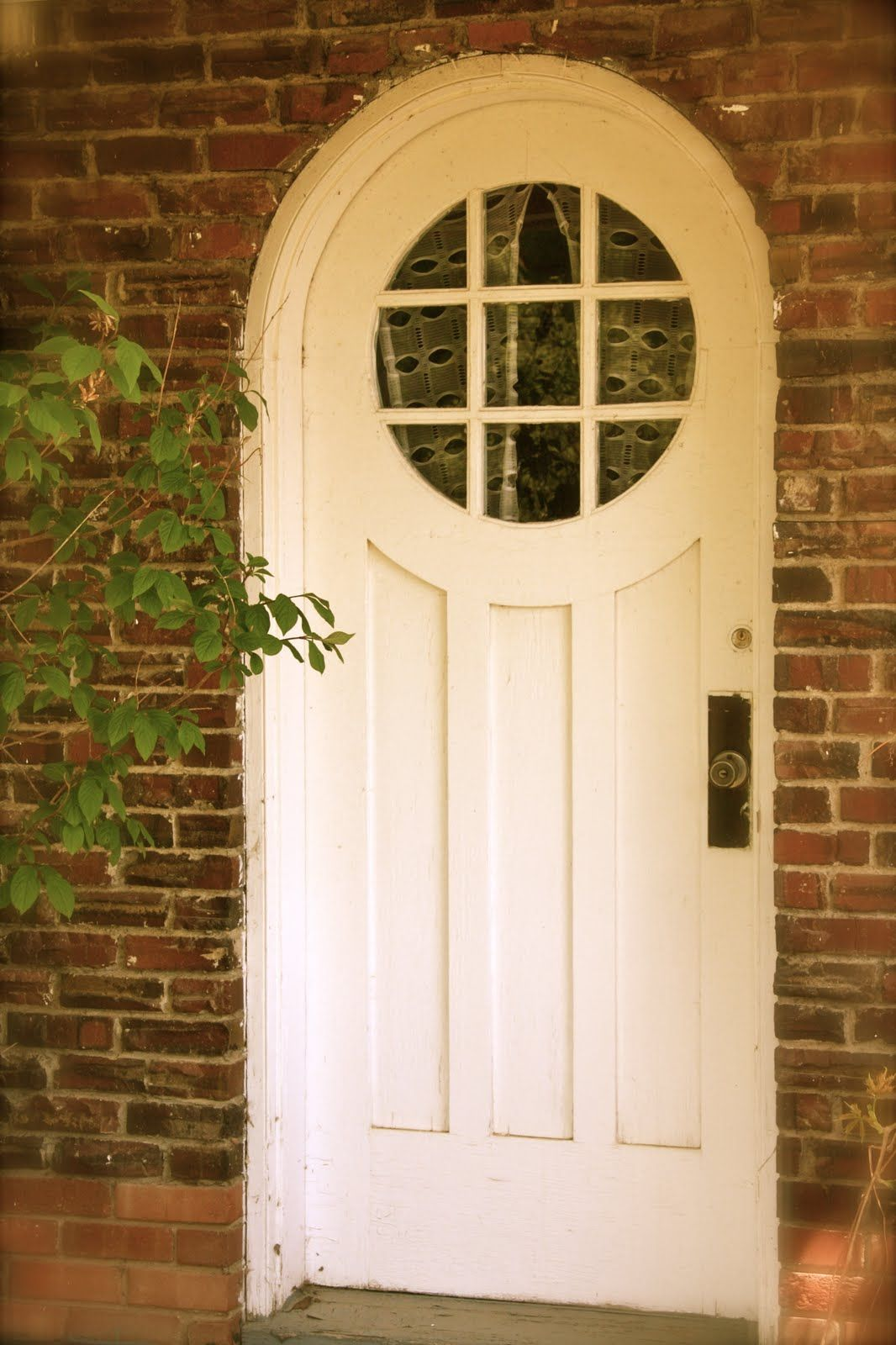 Country cottage front door with arched top and circular window with lights new front door for for Exterior door with round window