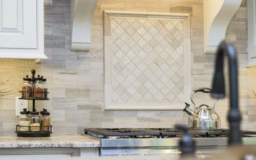 Gorgeous Woodgrain Porcelain Subway Tile Backsplash With Arabasque Accent Framed Over The Gas Cooktop In
