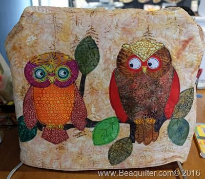 sewing machine cover with island batik and owl appliques