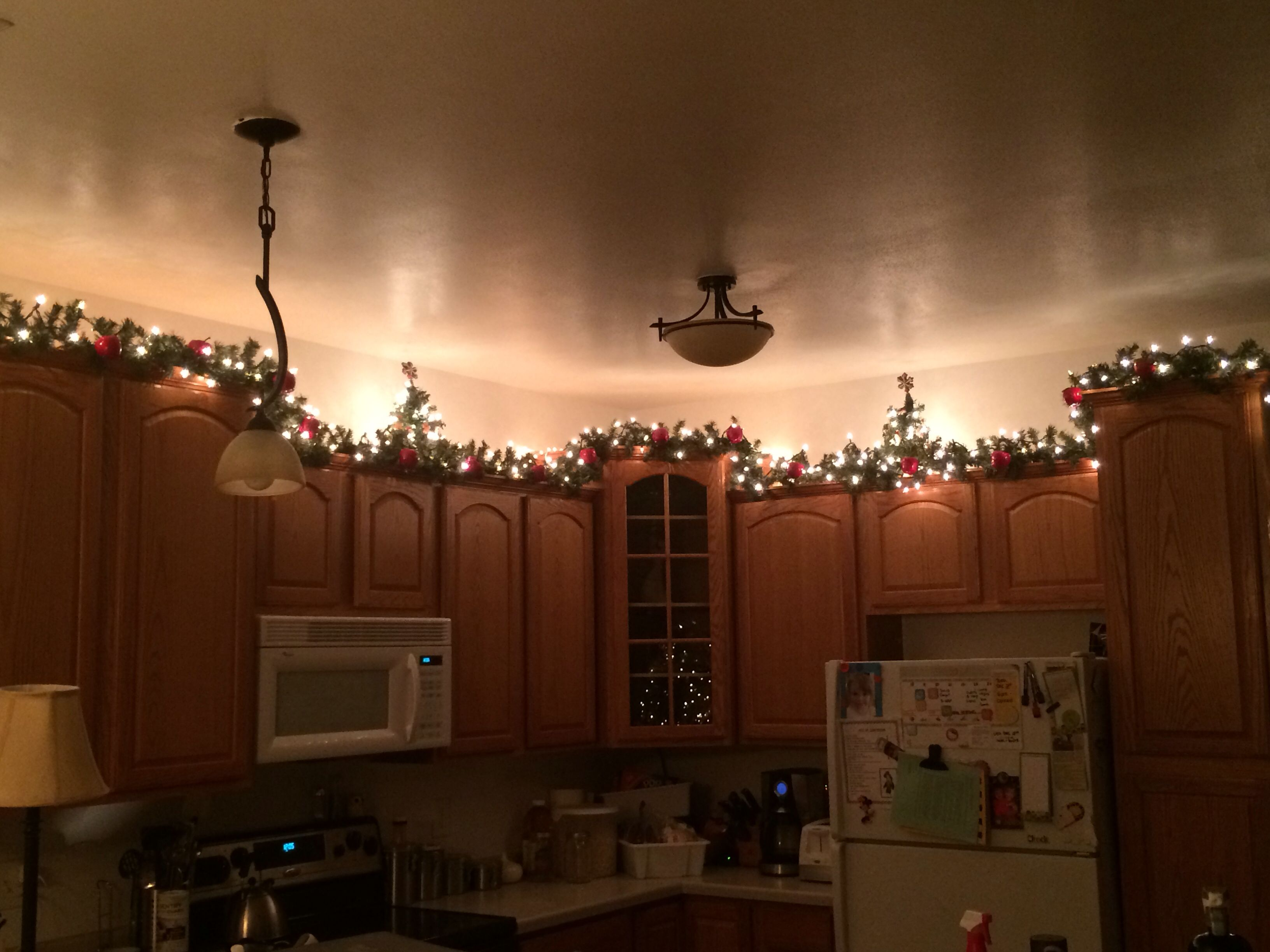 Christmas Garland W Lights And Apple Ornaments And Two Small Christmas Trees On My Kitchen Cabinet Christmas Deco Small Christmas Trees Christmas Inspiration