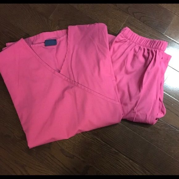 Cherokee scrub set Excellent condition, pink scrub set. Both size small, top is a cute mock wrap style. Flare bottoms. Cherokee Other