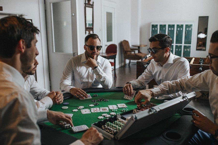 Groomsmen playing poker in the grooms room Grooms room