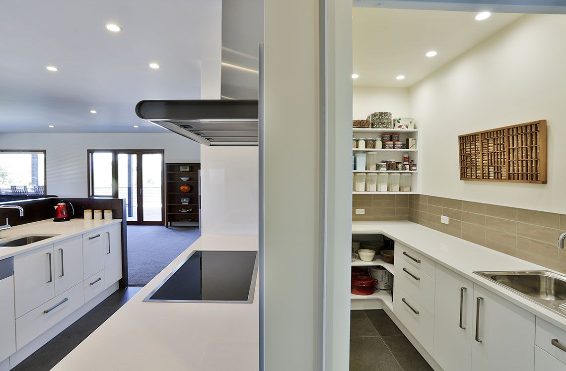This scullery runs behind the oven and stove bench in the main ...