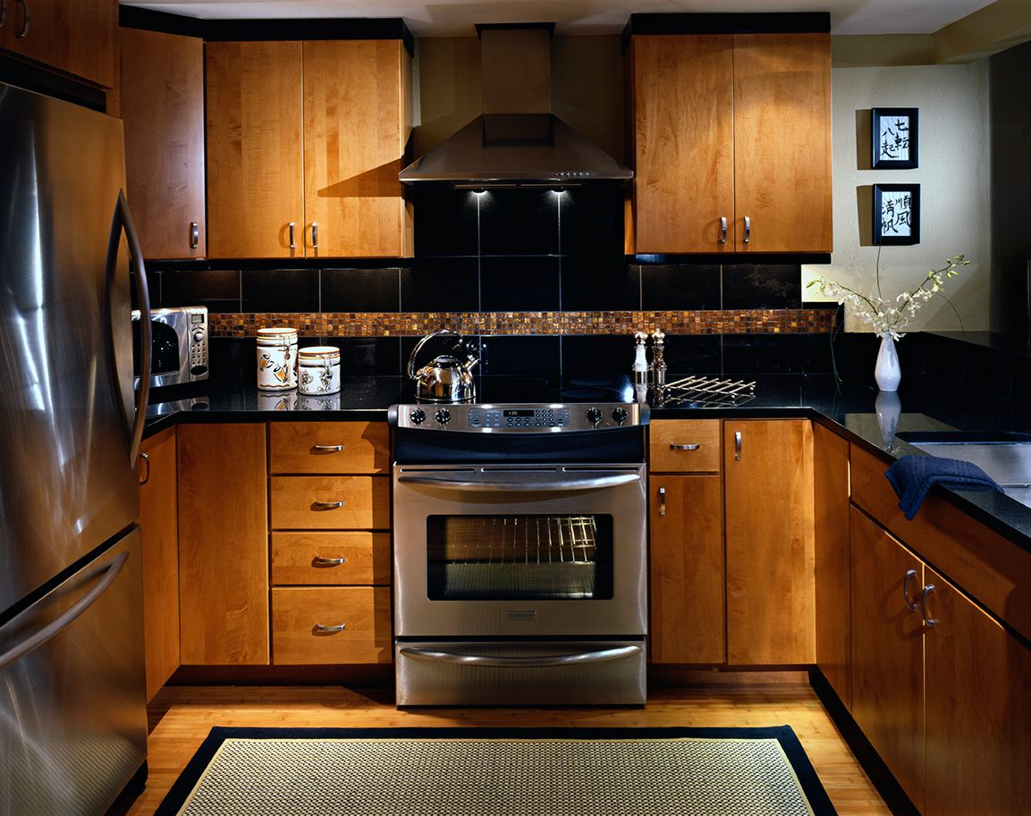 Condo Kitchen With Asian Feel Slab Maple Cabinet Doors Absolute Black Granite Slab Counters Bisazza Mo Kitchen Remodel Design Kitchen Remodel Kitchen Decor