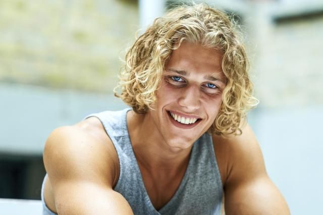 12 Guys Who Own Their Curly Hair Guy With Curly Surfer Hair