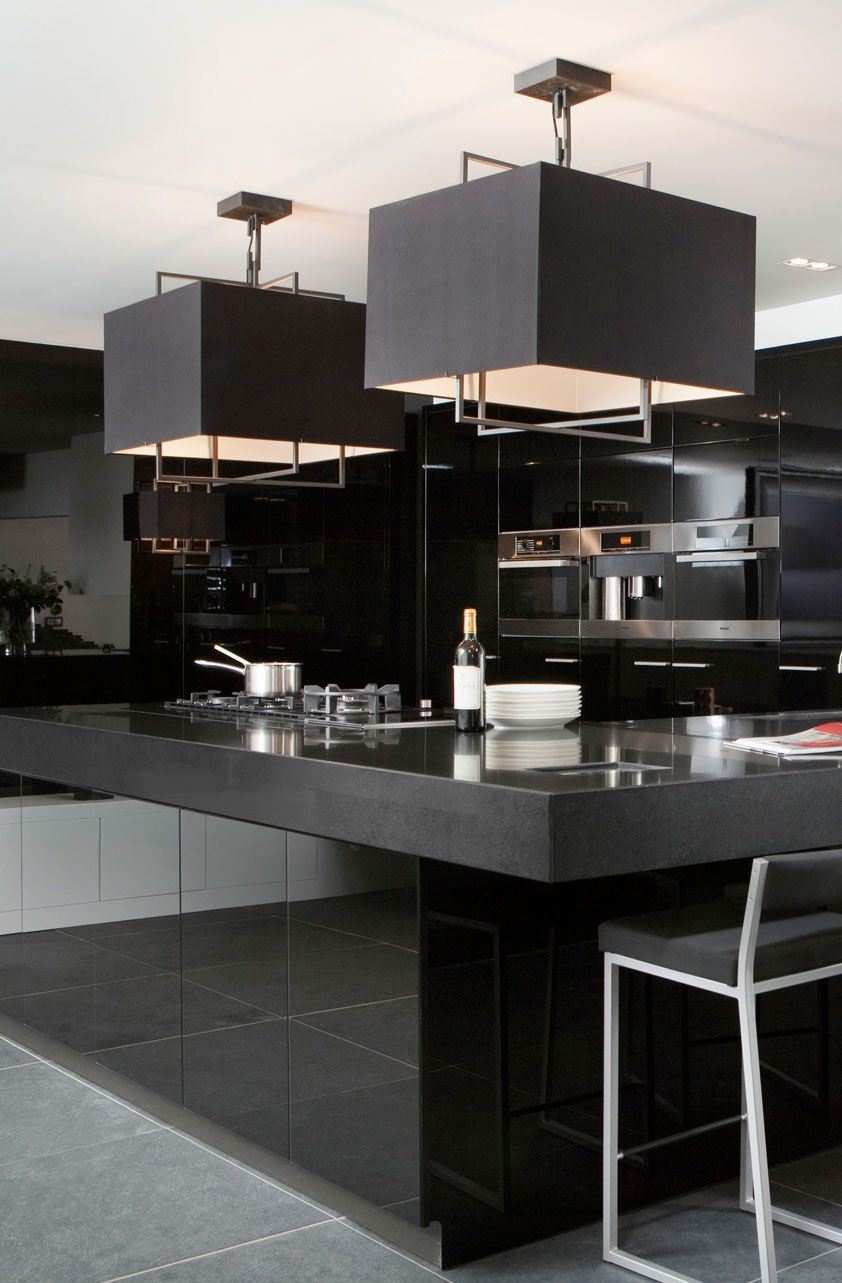 glamorous black modern kitchen square pendant lights over gloss black island unit layer